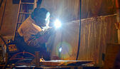 A welder working at shipyard — Stock Photo