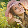 teen girl lying in meadow grass — Stock Photo