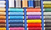 Colored spools of threads — Stock Photo