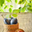Stock Photo: Plums in basket