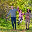 Young family spending time outdoor — Stock Photo #34235917