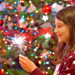 Stock Photo: Young girl holding sparkles