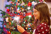 Young girl holding sparkles — Photo