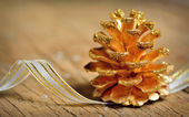 Pine cones isolated on old wood — Stock Photo
