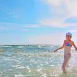 Girl running on water — Stock Photo