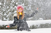 Teenager girl play with snow — Stok fotoğraf