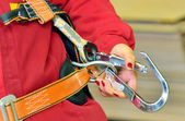 Woman and a fall protection harness — Stock Photo