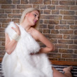 Young blonde woman with fur — Stockfoto