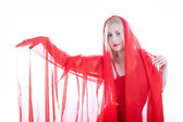 Young beauty woman in red fabric — Стоковое фото