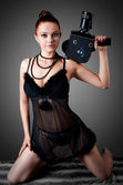 Young beauty woman with old camera — Stock Photo