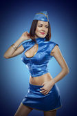 Sexy stewardess in blue uniform pin up shot — Stock Photo