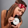 Young woman tries to eat the clock — Stock Photo #7342471