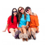 Three beautiful ladies sitting on white background — Stock Photo
