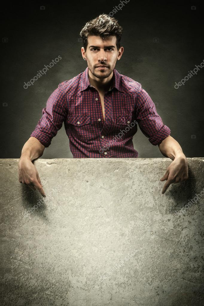 Photo of Attractive man with banner over grey background — Stock Photo #19661595