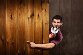 Advertising with megaphone and wooden messageboard — Stock Photo