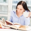 Female Student learning at home with different books — Stock Photo #23267730