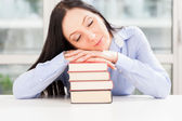 Pretty Student sleeping on book pile — ストック写真