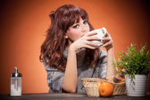 Woman is having breakfast — Stock Photo