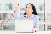 Woman drawing positive business growth — Stock Photo