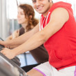 Mis doing workout on bicycle at gym — Stock Photo #25696643