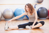 Young woman doing stretching exercise — Stock Photo