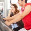 Man is doing workout on a bicycle at the gym — Stock Photo