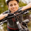 Stock Photo: Portrait of womwith mountain bike