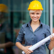 Stock Photo: Portrait of female constructor with blueprints