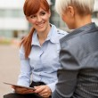 Two Businesswoman are having a conversation — Stock Photo