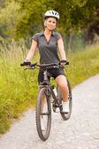 Portrait of woman with mountain bike — Stock Photo