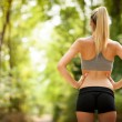 Sexy female with tonic bottom looking at running path — Stock Photo #28248003