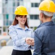 Stock Photo: Two female constructors meet each other