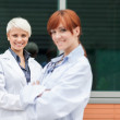Portrait of two female doctors — Stock Photo