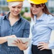 Female constructors are discussing their project — Stockfoto