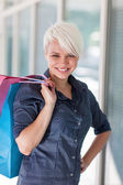 Attractive blonde woman with shopping bags — Stock Photo