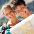 Closeup of couple in the mountains looking at the map — Stok fotoğraf