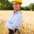 Stock Photo: Female architect inside a wheat field