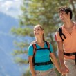 Young couple doing trekking in the mountains — Stock Photo