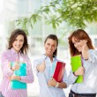 Three female students smiling — Stock Photo