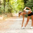 Sexy blonde woman is doing stretching exercises — Stock Photo