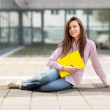 Portrait of female student with notebooks — Stock Photo #30475563