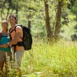 Couple is doing trekking in the woods — Stock Photo