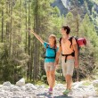 Couple is doing trekking in the mountains — Stock Photo
