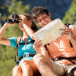 Closeup of couple in the mountains looking at the map — Stock Photo