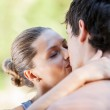 Beautiful couple in love kisses each other — Stock Photo #30475835