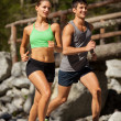 Young sporty couple is doing running exercises — Stock Photo