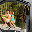 View of a couple that camps from the inside of a tent — Foto de Stock
