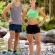 Stock Photo: Athletic couple in mountains with sporty outfit