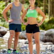 Athletic couple in the mountains with sporty outfit — Stock Photo