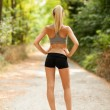 Sexy female with tonic bottom looking at running path — Foto Stock